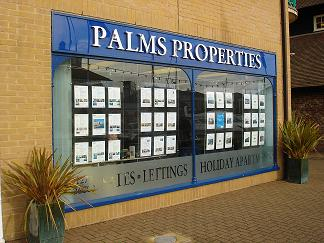 Palms Lettings Agent in Brighton Marina - image of front of office blue sign and windows, silver sig