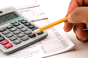 Property Tax Returns - Turney Associates Letting Agents in Cambridge - Pencil and Calculator