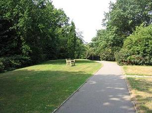 Image of park in Broadstone with green grass, park bench from Hillier Wilson Estate Agents in Broads