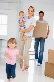 Moving Pad Letting Agents in Dagenham - Family moving into home with boxes