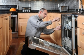 Oaktree Property Management Agents in Ealing - Man fixing dishwasher in Rented House