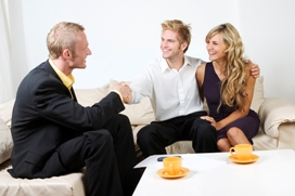 Lewis and Co - Letting Agents in St Austell - couple shaking agents hand on sofa