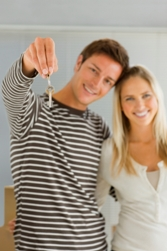 Laceys Letting & Management Agents in Yeovil - Couple holding new keys
