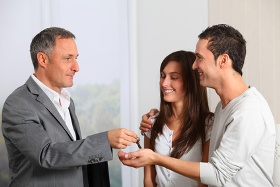 Atkinsons in Enfield - Estate Agent handing over keys to young couple