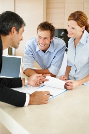 The Letting Line - Letting Agents in Enfield - Couple signing documents with letting agent