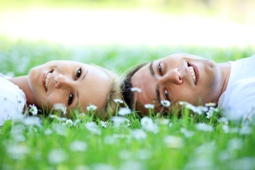 Hamble Estate Agents in Hamble - Couple relaxing on the grass
